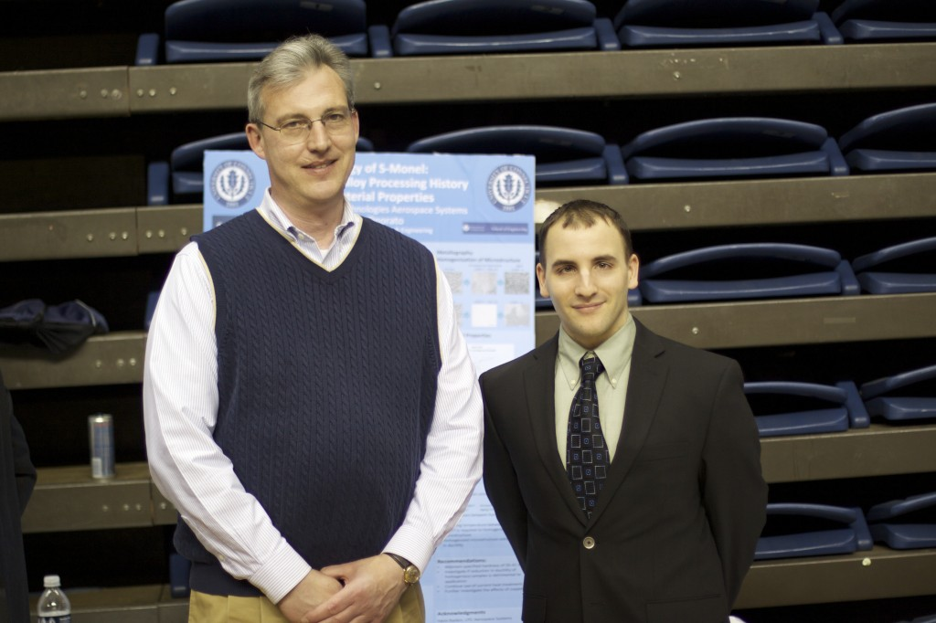 (From right to left) Steven Onorato with his faculty advisor Professor George Rossetti.