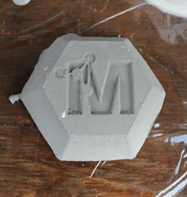 Clay slip-casted dish made from 3D printed object with MSE logo.