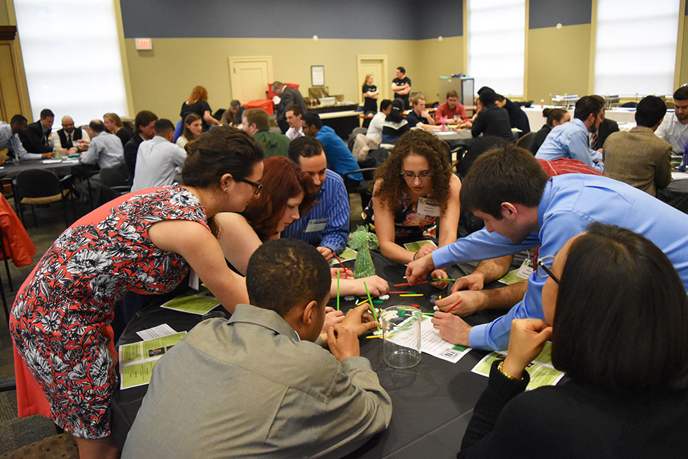 """Tables competed in a """"Race To Taste"""" competition where they had to build a structure with Kinnex. Left to right: Cam Hansel, Emily Beudoesa, Chelsea Hendrix, Shawn Fonseca (former UCMA president and alumnus), Alexandra Merkouriou (former UCMA president 2013-2015 and alumna), Benjamin Barard."""