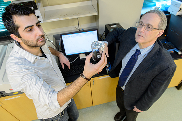 Altug Poyraz, left, a graduate student, with Steven Suib, Board of Trustees Distinguished Professor and director, IMS and GEMS Center of Excellence. (Peter Morenus/UConn Photo)