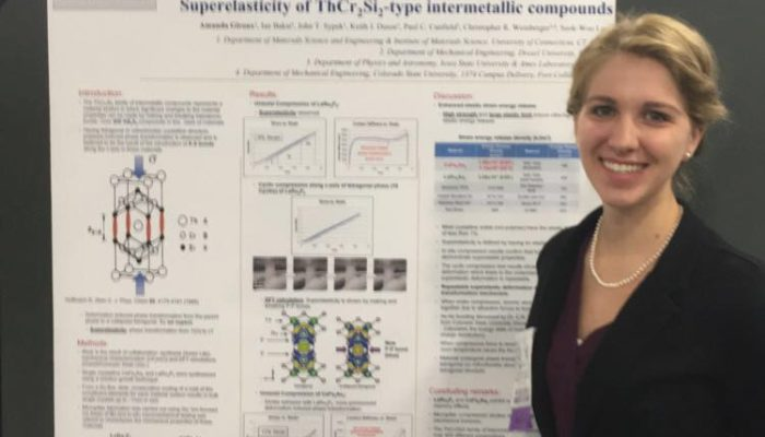 "Amanda Giroux presents her poster on the ""Superelasticity of ThCr2Si2-type intermetallic compounds""."