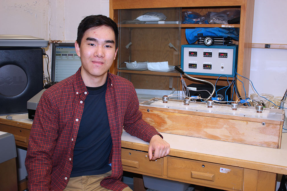 Andrew Nguyen, sixth-semester MSE undergraduate, works with a freeze-casting assembly dubbed the 'Freeze-Castinator 2000,' which consists of a liquid nitrogen cooling bath and temperature controller used to fabricate our multi-zonal scaffolds.