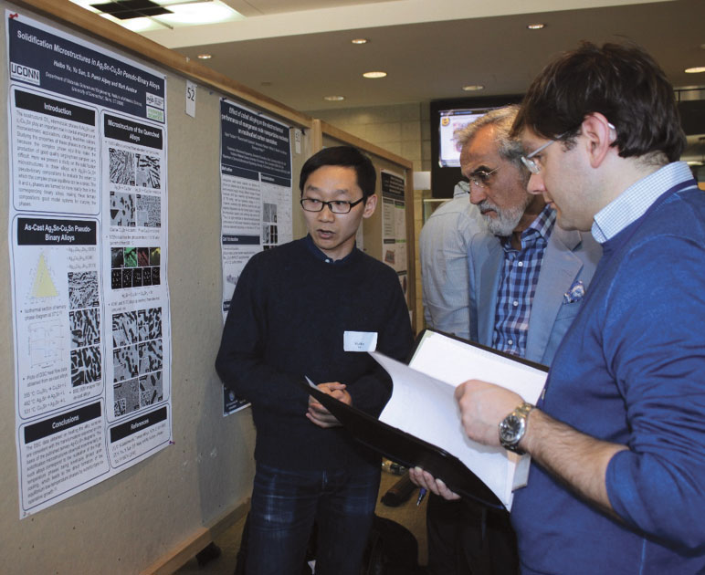 "Haibo Yu, left, presents his research titled ""Solidification Microstructures in Ag3Sn-Cu3Sn Psuedo-Binary Alloys"" at the School of Engineering Poster Session held in March 2017. Haibo has already published or contributed to 10 journal papers, with more in the process."
