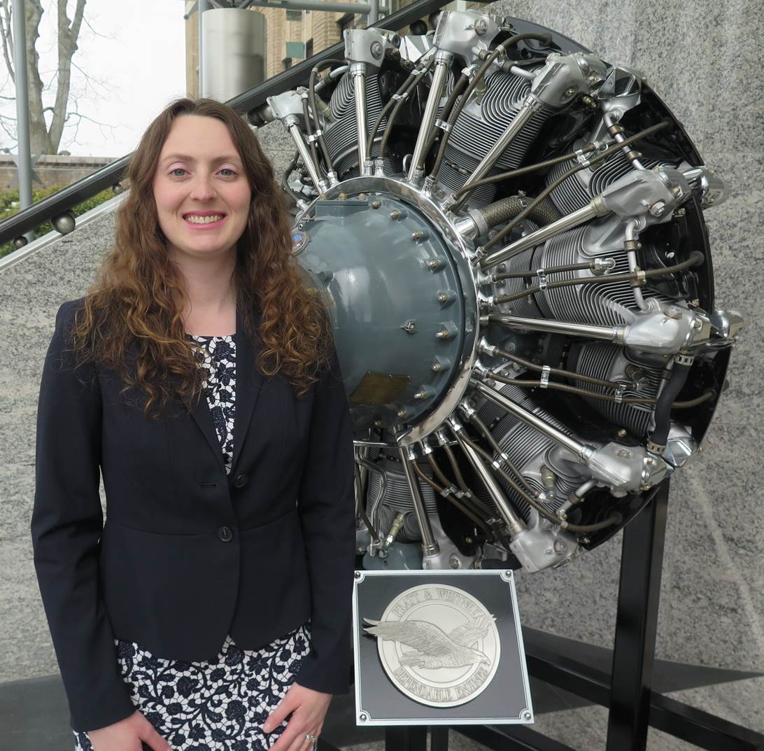 Katie Read in front of the Pratt &Whitney Wasp Engine