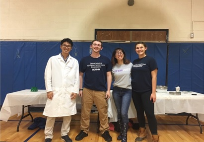 MSE assistant professor Dr. Seok-Woo Lee and MSE undergraduates Joe Tracey, Amanda Agui, and Victoria Reichelderfer pose in front of their demonstration table.