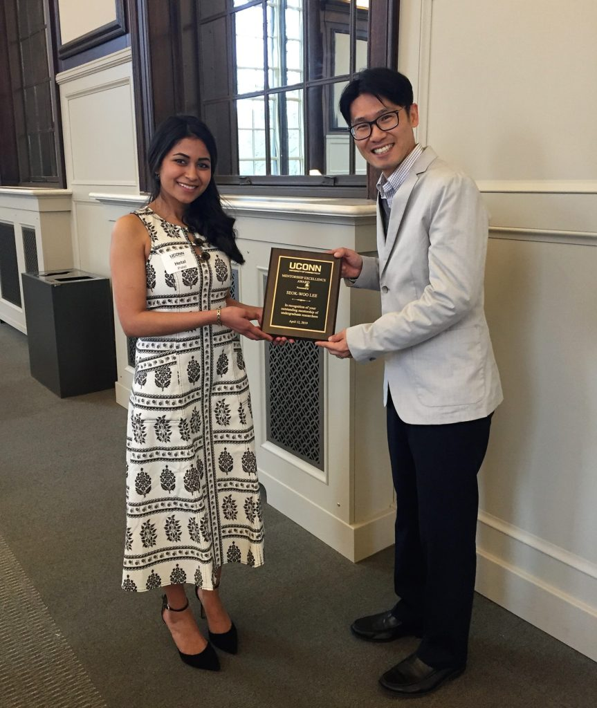 Dr. Lee and his student, Hetal Patel, accepting the Mentorship Excellence Award at the Frontiers in Undergraduate Research Reception on Friday, April 12, 2019
