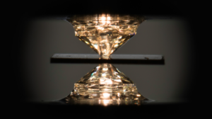 A novel metallic compound of hydrogen, carbon and sulfur exhibited superconductivity at a balmy 59 degrees Fahrenheit when pressurized between a pair of diamond anvils. Image credit: J. Adam Fenster / University of Rochester