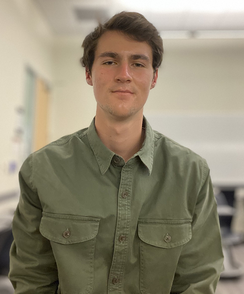 photo of Samuel Schaefer, MSE senior and research aide at Argonne National Laboratory conducting ground truth labeling for AI recognition of irradiation defects